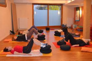 Shoulder bridge pieds sur coussins - cours collectifs Respiration Pilates